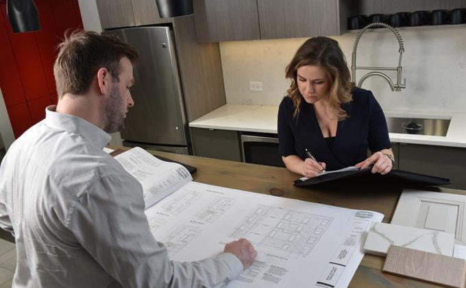 Rental advisors looking at floor plan layout